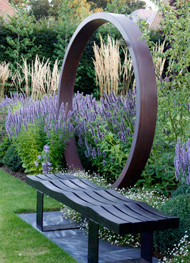 the bespoke copper scultpure seated within the new greencube garden