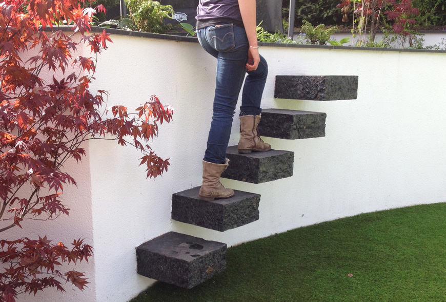 chunky cantilevered granite steps used in this greencube garden design in essex