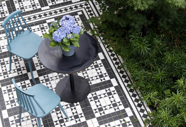 replica mosaic victorian tiles and yorkstone emulate the history of this house in greenwich, london