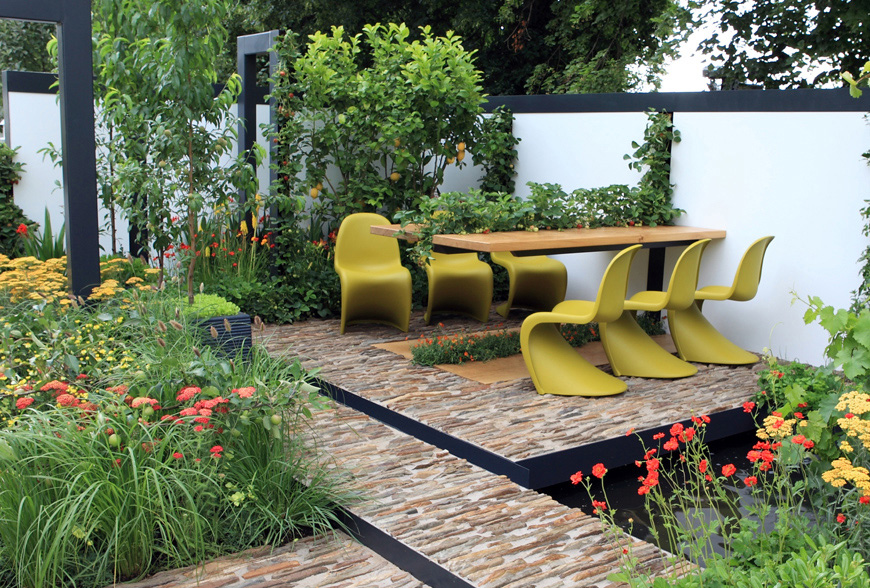 mediterranean planting surrounds a formal social space in greencube's hampton court garden