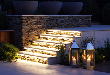 design detail showing underlit quartz paddlestone walls and steps in greencube modern garden design in Sevenoaks, Kent